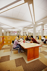 Students having a discussion in the library.